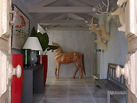 At one end of the long entrance hall a stunning focal point has been created with the life-size sculpture of a horse