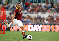 "Calcio: allenamento a porte aperte ""Open Day"" per la presentazione della Roma, a Roma, stadio Olimpico, 21 agosto 2013.<br /> AS Roma forward Francesco Totti kicks the ball during the club's Open Day training session at Rome's Olympic stadium, 21 August 2013.<br /> UPDATE IMAGES PRESS/Isabella Bonotto"