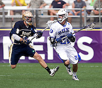 Ned Crotty (22) of Duke tries to get past David Earl (33) of Notre Dame during the NCAA Men's Lacrosse Championship held at M&T Stadium in Baltimore, MD.  Duke defeated Notre Dame, 6-5, to win the title in overtime.
