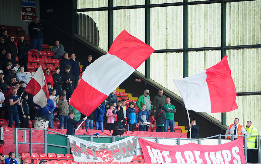 Lincoln City fans wave flags during the game<br /> <br /> Photographer Andrew Vaughan/CameraSport<br /> <br /> Vanarama National League - Lincoln City v Eastleigh - Saturday 22nd October 2016 - Sincil Bank - Lincoln<br /> <br /> World Copyright &copy; 2016 CameraSport. All rights reserved. 43 Linden Ave. Countesthorpe. Leicester. England. LE8 5PG - Tel: +44 (0) 116 277 4147 - admin@camerasport.com - www.camerasport.com