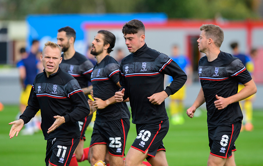 Lincoln City players, from left, Anthony Scully, Sean Roughan and James Jones during the pre-match warm-up<br /> <br /> Photographer Chris Vaughan/CameraSport<br /> <br /> The EFL Sky Bet League One - Saturday 12th September 2020 - Lincoln City v Oxford United - LNER Stadium - Lincoln<br /> <br /> World Copyright © 2020 CameraSport. All rights reserved. 43 Linden Ave. Countesthorpe. Leicester. England. LE8 5PG - Tel: +44 (0) 116 277 4147 - admin@camerasport.com - www.camerasport.com - Lincoln City v Oxford United