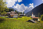 Village of Bschlab, farm buildings, homes and Maria-Schnee church with its onion shaped dome. Hahntennjoch pass, between imst and Boden, Austria.