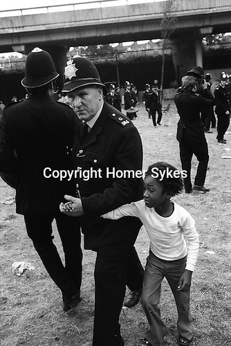 Notting hill Nottinghill Gate Carnival Riot, London W11 England 1976. Young girl being led away to safty.