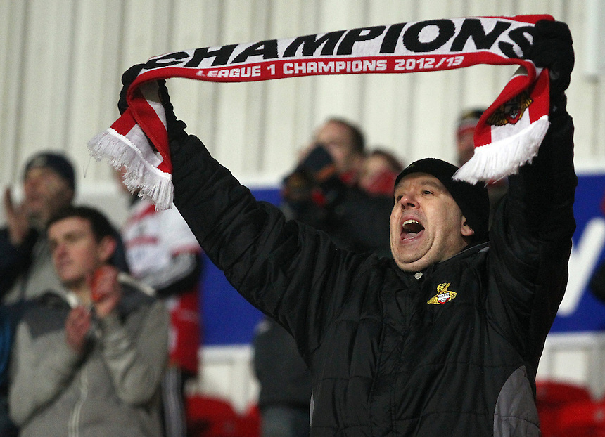 A Doncaster Rovers fan celebrates by holding up a 'Champions scarf as side win 3 - 0<br /> <br /> Photo by Rich Linley/CameraSport<br /> <br /> Football - The Football League Sky Bet Championship - Doncaster Rovers v Wigan Athletic - Saturday 18th January 2014 - Keepmoat Stadium - Doncaster<br /> <br /> &copy; CameraSport - 43 Linden Ave. Countesthorpe. Leicester. England. LE8 5PG - Tel: +44 (0) 116 277 4147 - admin@camerasport.com - www.camerasport.com