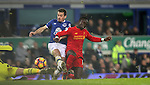 Maarten Stekelenburg of Everton goes off injured after clashing with Leighton Baines of Everton and Sadio Mané of Liverpool during the English Premier League match at Goodison Park, Liverpool. Picture date: December 19th, 2016. Photo credit should read: Lynne Cameron/Sportimage