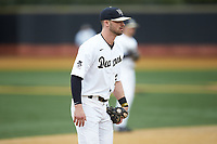 Wake Forest Demon Deacons third baseman Jake Mueller (23) on defense against the Sacred Heart Pioneers at David F. Couch Ballpark on February 15, 2019 in  Winston-Salem, North Carolina.  The Demon Deacons defeated the Pioneers 14-1. (Brian Westerholt/Four Seam Images)