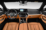 Stock photo of straight dashboard view of 2021 BMW 5-Series Luxury 5 Door Wagon Dashboard