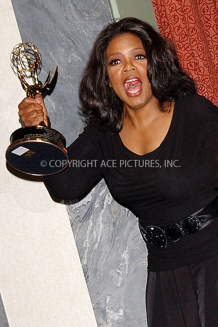 WWW.ACEPIXS.COM . . . . . ....NEW YORK, NOVEMBER 21, 2005....Oprah Winfrey at the 2005 International Emmy Awards Gala Press Room..Please byline: KRISTIN CALLAHAN - ACE PICTURES.. . . . . . ..Ace Pictures, Inc:  ..Philip Vaughan (212) 243-8787 or (646) 679 0430..e-mail: info@acepixs.com..web: http://www.acepixs.com