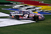 Dale Earnhardt celebrates his 1998 Daytona 500 win by turning donuts in the grass at Daytona International Speedway, February 1998. (Photo by Brian Cleary/www.bcpix.com)