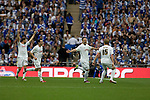 Swansea players celebrating their team's third goal, scored by Scott Dobbie (second right) during the Npower Championship play-off final between Reading (blue) and Swansea City at Wembley Stadium. The match was won by Swansea by 4 goals to 2 watched by a crowd of 86,581. Swansea became the first Welsh team to reach the top division of English football since they themselves played there in 1983.