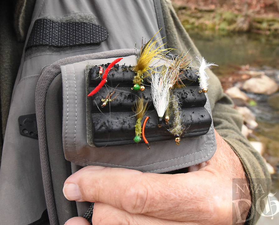 NWA Democrat-Gazette/FLIP PUTTHOFF<br />Tying flies is an art form that goes hand in hand with trout fishing, says Floyd Redburn. Here he shows   Nov. 17  2017 some flies he carries on his fishing vest.