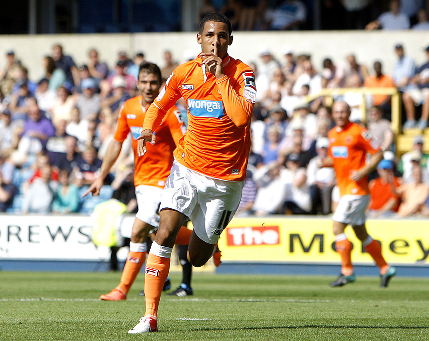 Blackpool's Thomas Ince celebrates scoring his sides first goal 1-0..Football - npower Football League Championship - Millwall v Blackpool - Saturday 18th August 2012 - The Den - Millwall - London..