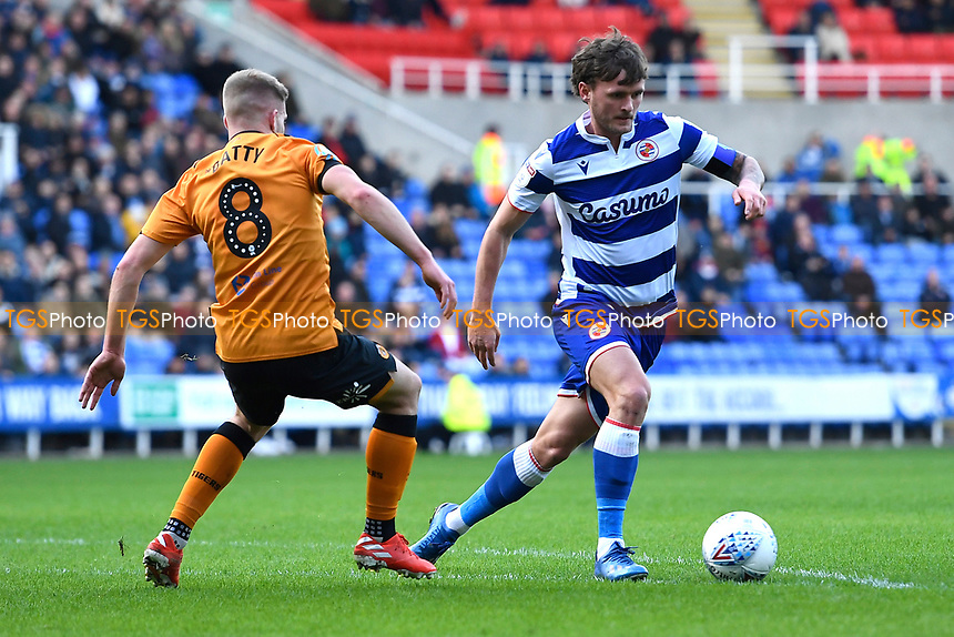 John Swift of Reading gets to the ball before Daniel Batty of Hull City during Reading vs Hull City, Sky Bet EFL Championship Football at the Madejski Stadium on 8th February 2020
