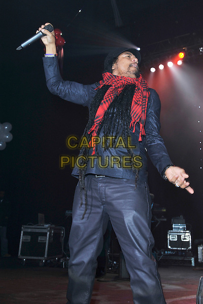 "MAXI PRIEST .Performs as part of the ""Reggae got soul valentine showcase"" at Brixton Academy, London, England, .February 13th 2011..music live on stage concert gig half length red scarf microphone  black cap hat jacket dancing .CAP/MAR.© Martin Harris/Capital Pictures."