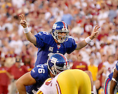 Landover, MD - September 23, 2007 -- New York Giants quarterback Eli Manning (10) shouts out signals during a scoring drive against the Washington Redskins at FedEx Field in Landover, MD on Sunday, September 23, 2007.  The Giants won the game 24 - 17..Credit: Ron Sachs / CNP.(RESTRICTION: NO New York or New Jersey Newspapers or newspapers within a 75 mile radius of New York City)