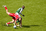 04/14/2011 - Timbers' midfielder James Marcelin trips up Andrew Jacobson as the Portland Timbers play FC Dallas during the Portland Timbers' second MLS home match at Jeld-Wen Field Sunday.  ..Photo by Christopher Onstott