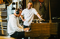 ESPN Hang Time host Sam Alipour (right) looks on as Carolina Panthers Running Back Christian McCaffrey plays piano at The Decibel Garden in Denver, Colorado, Wednesday, June 26, 2019. <br />  <br /> Photo by Matt Nager