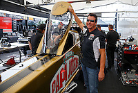 Aug 19, 2016; Brainerd, MN, USA; Papa Johns pizza founder John Schnatter checks out the dragster of NHRA top fuel driver Leah Pritchett in the pits during qualifying for the Lucas Oil Nationals at Brainerd International Raceway. Mandatory Credit: Mark J. Rebilas-USA TODAY Sports