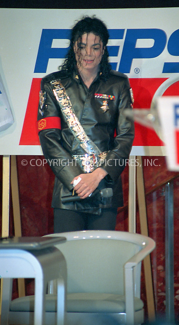 WWW.ACEPIXS.COM................June 25 2009....File picture of Michael Jackson who died following cardiac arrest at his home in LA, June 25 2009....Image date 2004....Please byline: R. BOCKLET-ACEPIXS.COM  ..  ***  ..Ace Pictures, Inc:  ..tel: (646) 769 0430..e-mail: info@acepixs.com..web: http://www.acepixs.com