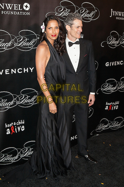 NEW YORK, NY - NOVEMBER 7, 2013: Padma Lakshmi, Peter Twyman at Keep A Child Alive's 10th Annual Black Ball at Hammerstein Ballroom on November 7, 2013 in New York City.<br /> CAP/MPI/COR<br /> &copy;Corredor99/ MediaPunch/Capital Pictures