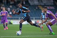 Gozie Ugwu of Wycombe Wanderers  plays a pass under pressure from Curtis Nelson of Plymouth Argyle during the Sky Bet League 2 match between Wycombe Wanderers and Plymouth Argyle at Adams Park, High Wycombe, England on 12 September 2015. Photo by Andy Rowland.