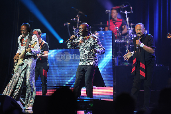 HOLLYWOOD FL - OCTOBER 15 : Verdine White, Philip Bailey and Ralph Johnson of Earth, Wind & Fire perform at Hard Rock Live held at the Seminole Hard Rock Hotel & Casino on October 15, 2014 in Hollywood, Florida. Credit: mpi04/MediaPunch