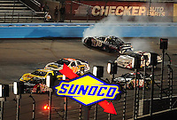 Apr 11, 2008; Avondale, AZ, USA; NASCAR Nationwide Series driver Jamie McMurray (16) crashes during the Bashas Supermarkets 200 at the Phoenix International Raceway. Mandatory Credit: Mark J. Rebilas-
