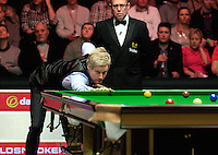 Neil Robertson pots a long red during the Dafabet Masters Quarter Final 2 match between Judd Trump and Neil Robertson at Alexandra Palace, London, England on 15 January 2016. Photo by Liam Smith / PRiME Media Images.