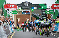 Picture by Allan McKenzie/SWpix.com - 15/05/2018 - Cycling - OVO Energy Tour Series Mens Race Round 2:Motherwell - The peloton climbs the finishing straight to pass under the gantry, OVO Energy, Eisberg, Festina, branding.