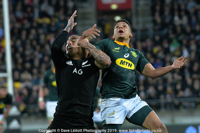 NZ's Aaron Smith and South Africa's Herschel Jantjies leap up for the ball before Jantkies' try during the Rugby Championship rugby union match between the New Zealand All Blacks and South Africa Springboks at Westpac Stadium in Wellington, New Zealand on Saturday, 27 July 2019. Photo: Dave Lintott / lintottphoto.co.nz