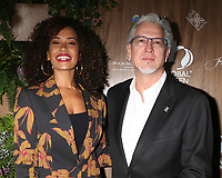 LOS ANGELES - FEB 20:  Danni Washington, Michael Cain at the Global Green 2019 Pre-Oscar Gala at the Four Seasons Hotel on February 20, 2019 in Beverly Hills, CA