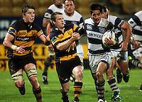 Taranaki halfback Brett Goodin tries to bring down Ash Moeke. Air New Zealand Cup rugby match - Taranaki v Auckland at Yarrows Stadium, New Plymouth, New Zealand. Friday 9 October 2009. Photo: Dave Lintott / lintottphoto.co.nz