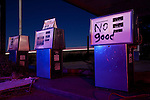 The view on a moonlit night of the pumps at an abandoned gas station located along historic Route 66, near Joseph City, Arizona