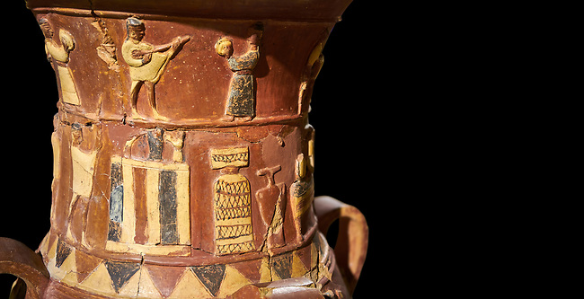Close up of the Inandik Hittite relief decorated cult libation vase decorated with a women and man relief figures coloured in cream, red and black playing instruments, in the register below is a cult altar, mid to late 16th century BC - İnandıktepe, Turkey. Against a black background