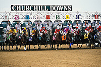 Thoroughbred race horses leaving starting gate, Churchill Downs, Louisville, Kentucky