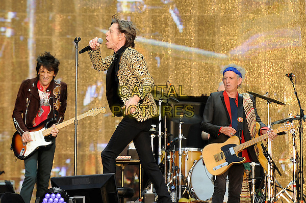 Ronnie Wood, Mick Jagger and Keith Richards of The Rolling Stones <br /> performing at Barclaycard British Summertime, Hyde Park, London, England, UK, <br /> 13th July 2013.<br /> music concert gig festival live on stage  half length microphone gold black patterned blazer jacket singing side playing guitar <br /> CAP/MAR <br /> &copy; Martin Harris/Capital Pictures