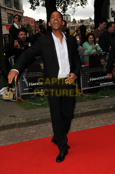 "WILL SMITH .Attending the UK Gala Premiere of ""Hancock"" held at the Vue West End, Leicester Square, London, England..June 18th 2008.full length black suit white shirt hand mouth open yelling screaming .CAP/CAS.©Bob Cass/Capital Pictures."