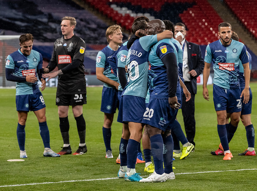Wycombe Wanderers' Adebayo Akinfenwa (right) celebrates promotion with team mate Matthew Bloomfield <br /> <br /> Photographer Andrew Kearns/CameraSport<br /> <br /> Sky Bet League One Play Off Final - Oxford United v Wycombe Wanderers - Monday July 13th 2020 - Wembley Stadium - London<br /> <br /> World Copyright © 2020 CameraSport. All rights reserved. 43 Linden Ave. Countesthorpe. Leicester. England. LE8 5PG - Tel: +44 (0) 116 277 4147 - admin@camerasport.com - www.camerasport.com