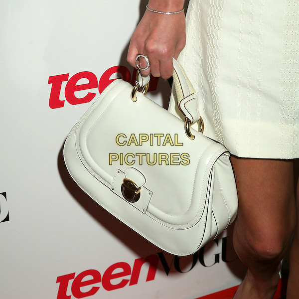 "NICKY HILTON - BAG.At Teen Vogue's ""Young Hollywood"" Issue Party at the Sunset Tower Hotel, West Hollywood, California, .USA,20 September 2006..whte handle bag purse close up gold buckle.Ref: ADM/BP.www.capitalpictures.com.sales@capitalpictures.com.©Byron Purvis/AdMedia/Capital Pictures."