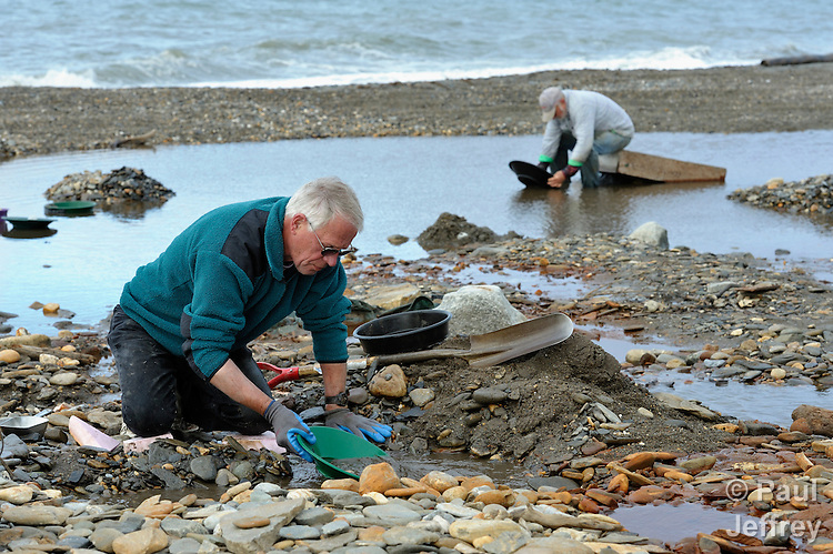 Prospectors pan for gold on the beach east of Nome, Alaska. More than a century after a gold rush led to the establishment of Nome, higher gold prices and a television reality show have brought thousands of new miners to the remote Bering Sea community.
