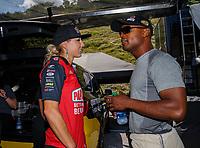 Jun 18, 2017; Bristol, TN, USA; NHRA top fuel driver Leah Pritchett (left) talks with teammate Antron Brown during the Thunder Valley Nationals at Bristol Dragway. Mandatory Credit: Mark J. Rebilas-USA TODAY Sports