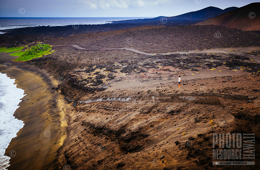 A man takes in the view along Road to the Sea, Ocean View, Hawa'i Island.