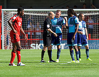 Captain Garry Thompson of Wycombe Wanderers has words with Referee Nick Tinselly during the Sky Bet League 2 match between Crawley Town and Wycombe Wanderers at Broadfield Stadium, Crawley, England on 6 August 2016. Photo by Alan  Stanford / PRiME Media Images.
