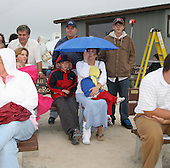 "Sharon Fasce (under umbrella) with her three children; Matt 11, holding Nicholas 3 and Chris 13 (R), at the end of memorial ceremonies for United Flight 93 on the fifth anniversary of 9-11, Monday September 11, 2006 in Shanksville, Pa. ""I took the children out of school,"" explains Ms. Fasce. ""I wanted them to experience the moment."" /// Mourners visit United Flight 93 memorial site on 5th anniversay."