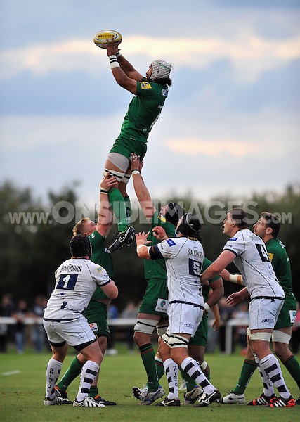 Blair Cowan rises high to win lineout ball. Pre-season friendly match, between London Irish and Bristol Rugby on August 22, 2014 at Hazelwood in Middlesex, England. Photo by: Patrick Khachfe / JMP