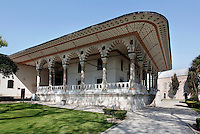 Low angle view of the Audience Chamber (Arz Odasi), 15th century, Third Courtyard, Topkapi Palace, 1459, Istanbul, Turkey. The Audience Chamber is in the form of an Ottoman kiosk, with a colonnade of 22 columns supporting its roof with overhanging eaves. The Topkapi Palace, commissioned by Sultan Mehmed II, was the main residence of the Ottoman Sultans in Istanbul. The historical areas of the city were declared a UNESCO World Heritage Site in 1985. Picture by Manuel Cohen.