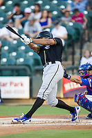 Omaha Storm Chasers outfielder Justin Maxwell (46) swings the bat during the Pacific Coast League baseball game against the Round Rock Express on June 1, 2014 at the Dell Diamond in Round Rock, Texas. The Express defeated the Storm Chasers 11-4. (Andrew Woolley/Four Seam Images)