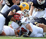 SIOUX FALLS, SD - SEPTEMBER 7:  Jamal Samaha #92 from Augustana gets physical while bringing down Brandon Schell #28 from Minnesota State University Moorhead in the first quarter of their game Saturday at Augustana. (Photo by Dave Eggen/Inertia)