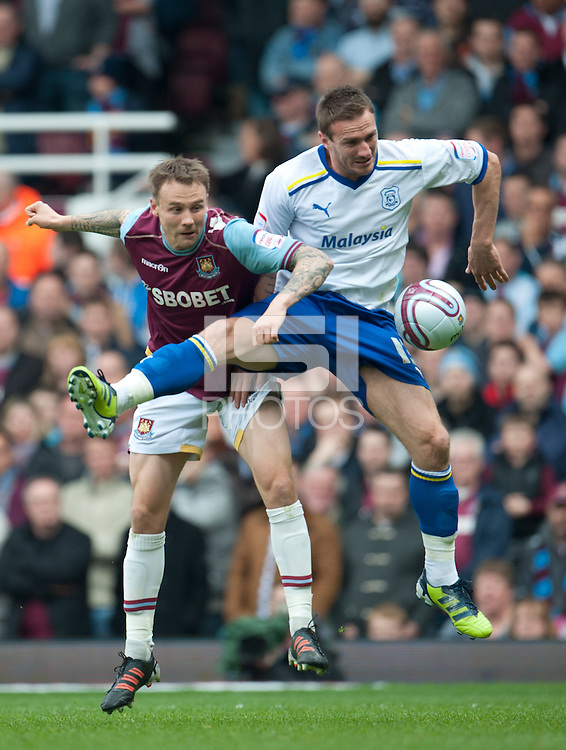 Matt Taylor of West Ham United and Liam Lawrence of Cardiff City.