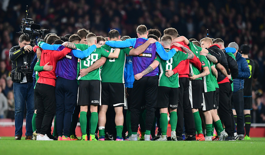 The Lincoln City players in a huddle on the pitch at the end of the game<br /> <br /> Photographer Chris Vaughan/CameraSport<br /> <br /> The Emirates FA Cup Quarter-Final - Arsenal v Lincoln City - Saturday 11th March 2017 - The Emirates - London<br />  <br /> World Copyright &copy; 2017 CameraSport. All rights reserved. 43 Linden Ave. Countesthorpe. Leicester. England. LE8 5PG - Tel: +44 (0) 116 277 4147 - admin@camerasport.com - www.camerasport.com